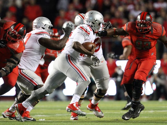 Ohio State quarterback J.T. Barrett carries during the first quarter against Rutgers, Saturday, October 24, 2015, in Piscataway.