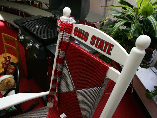 Gas grill and Ohio State rocking chair.