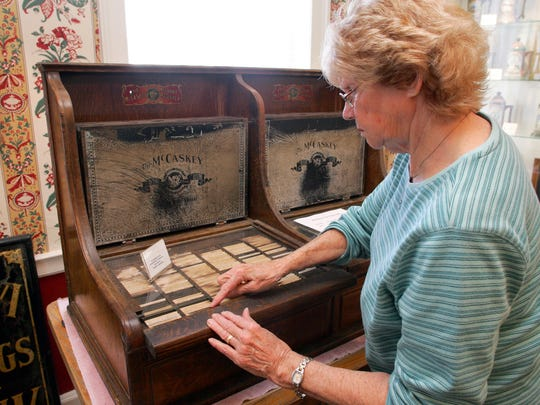 Phyllis Riley, curator of the Hufford House Museum in Utica, demonstrates how an accounting system that was once used by Bill Bain's Hardware and Waddell's Hardware functions.The Utica Historical Society is in the process of completing several major improvements to the Hufford House that gives the museum more storage space and a more attractive exterior. They are hoping they can attract more people to visit the museum.