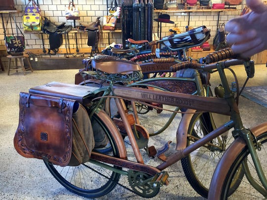 Will Leather Goods -- a Oregon based leather shop specializing in bags, belts, shoes and home goods -- features a section of the store that sells reclaimed and vintage items, including old bicycles, on Monday, Nov. 2, 2015.