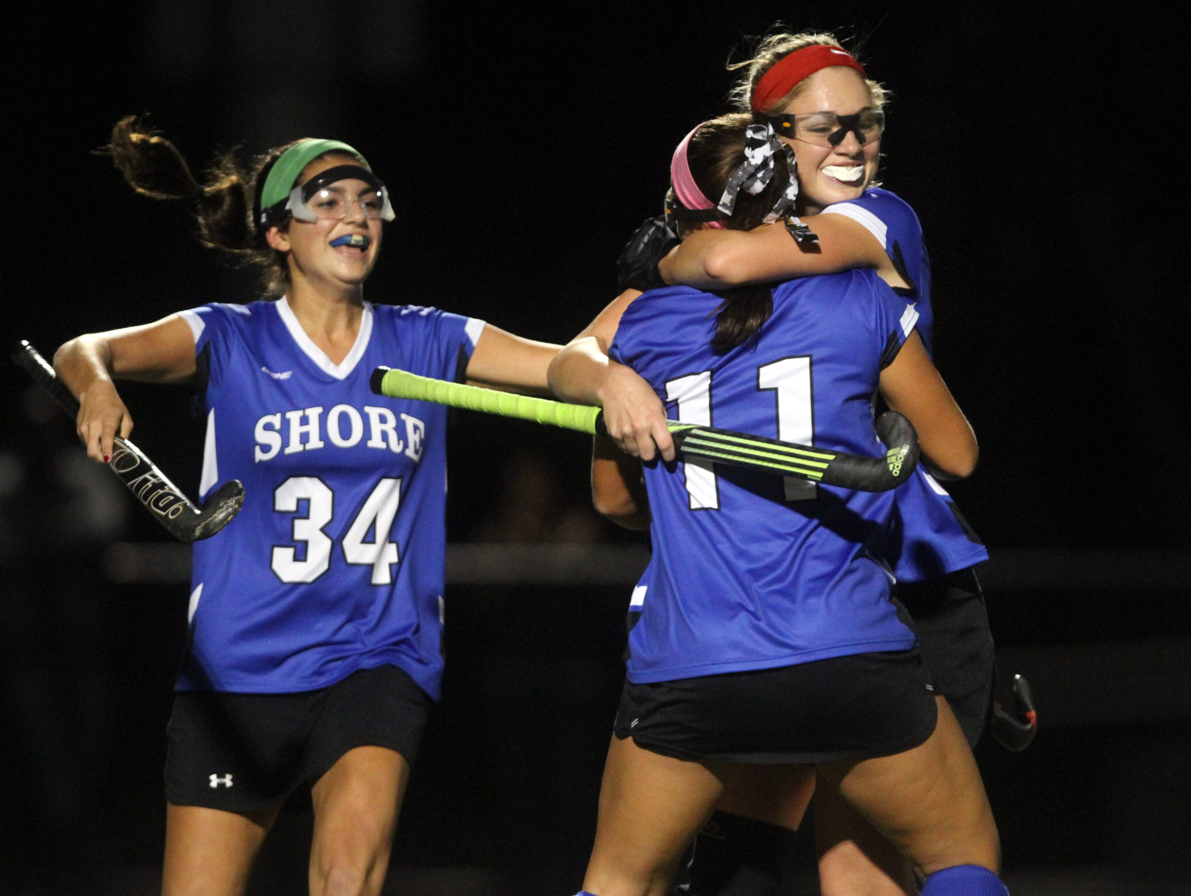 Shore Regional's Annie Deusch (11) celebrates a first half goal with teammates Jessica Welch and Kelsey O'Neill (34), Wednesday, November 11, 2015, at A.L. Johnson in Clark.