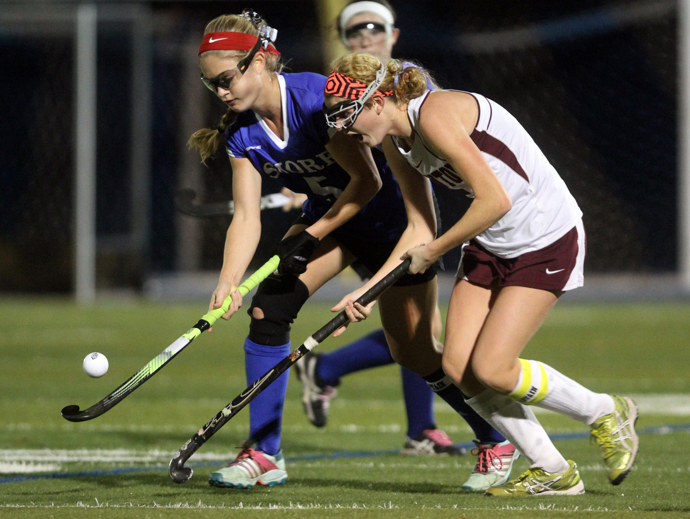 Shore Regional's Jessica Welch, left, battles for possession with Newton's Emily Weiss during the first half, Wednesday, November 11, 2015, at A.L. Johnson in Clark.
