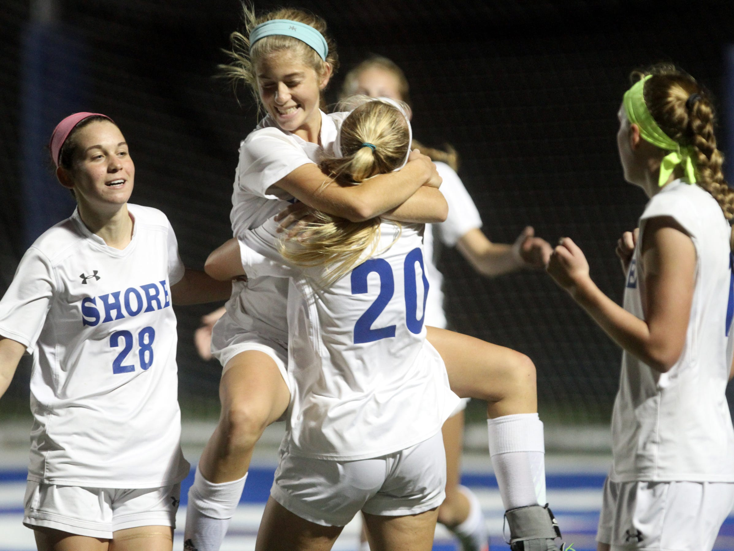 Shore Regional's Frankie McDonough leaps into the arms of teammate Sophie Hauritz after scoring a second half goal against Metuchen in the Central Group I girls soccer sectional final, Thursday, November 12, 2015, in West Long Branch.
