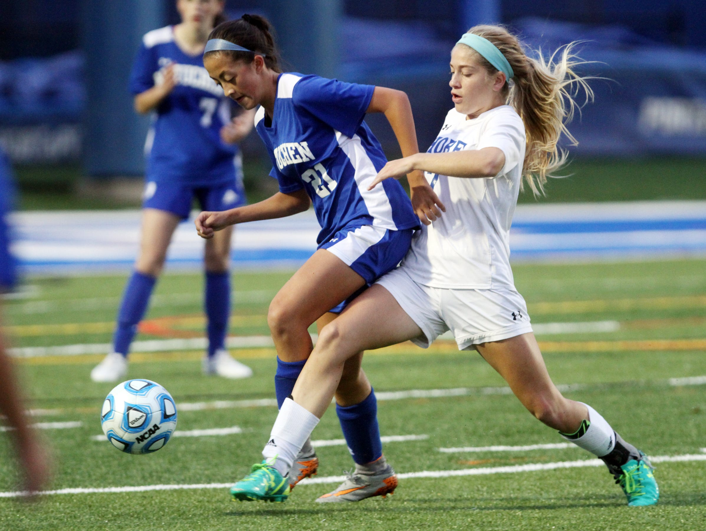 Metuchen's Mya Stolarski battles for possession with Shore Regional's Frankie McDonough during Central Group I girls soccer sectional final, Thursday, November 12, 2015, in West Long Branch.