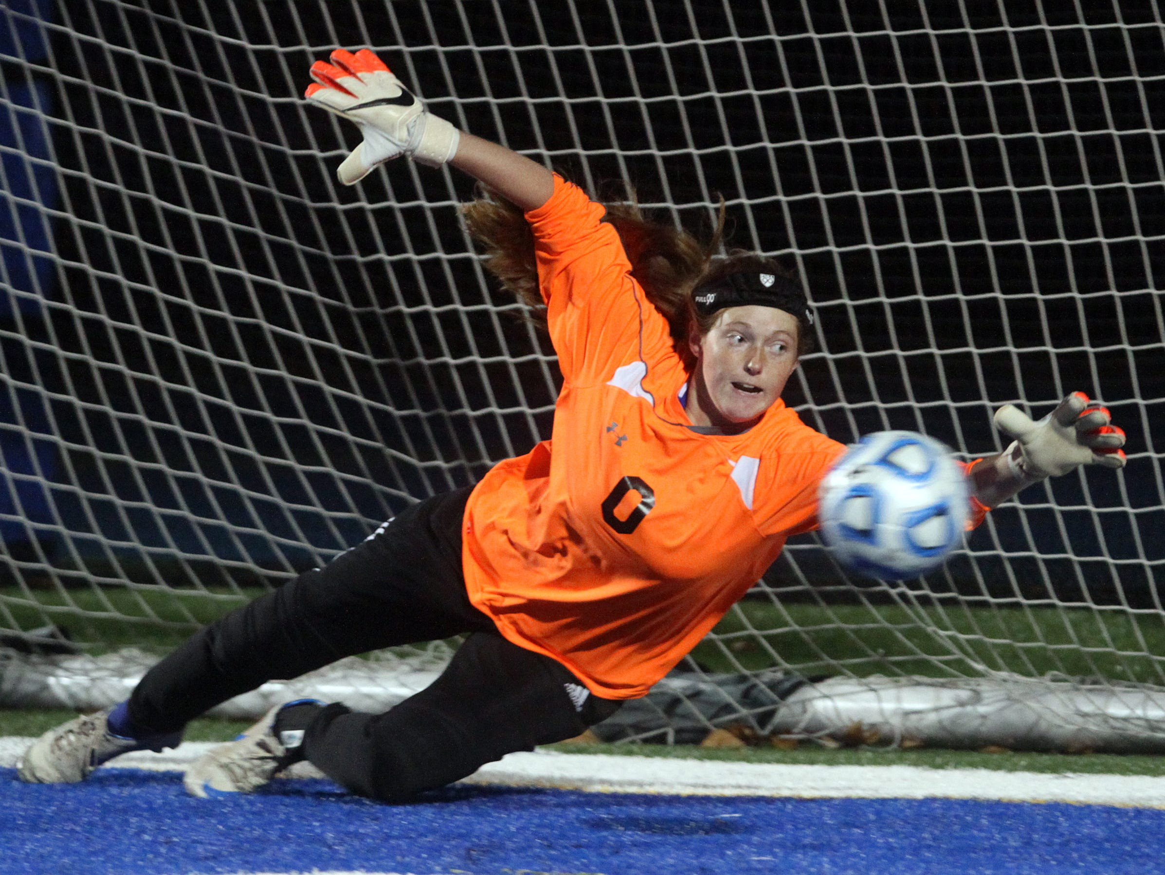 A penalty kick by Shore Regional's Frankie McDonough gets past Metuchen goalie Emily Buchanan in the Central Group I girls soccer sectional final, Thursday, November 12, 2015, in West Long Branch.