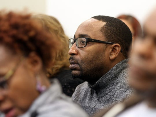 Michael Melton watches the arraignments of James Fair