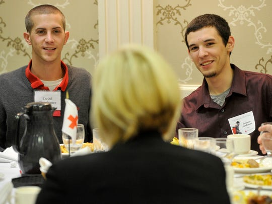"David Dranbauer, left, and his friend Connor Cashman, right, are all smiles during the breakfast that recognized Dranbauer for his ""Good Samaritan"" hero award during the annual ""Heroes Breakfast"" held by the South Central Pennsylvania chapter of the American Red Cross at the Wyndham Garden Hotel in West Manchester Township on Thursday, Nov. 19, 2015."