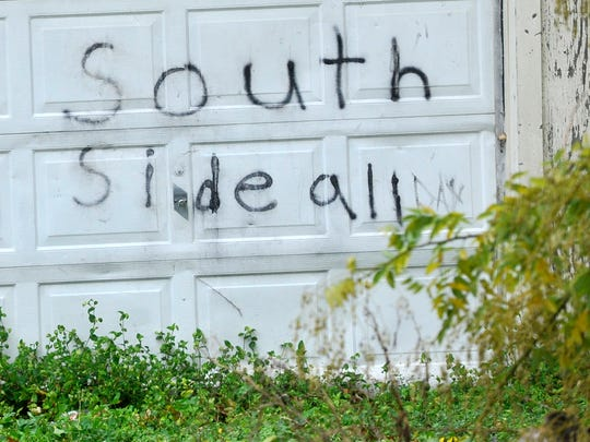 In this file photo from Nov. 19, 2015, a garage is seen covered in what appears to be graffiti in support of the Southside gang in York.
