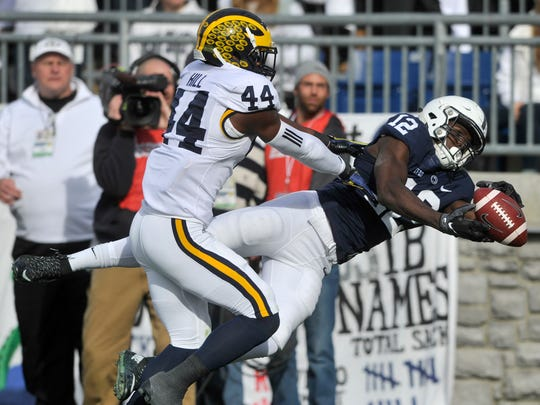Penn State wide receiver Chris Godwin drops a pass while being covered by Michigan's Delano Hill during the Nittany Lions' 28-16 loss to Michigan on Saturday.