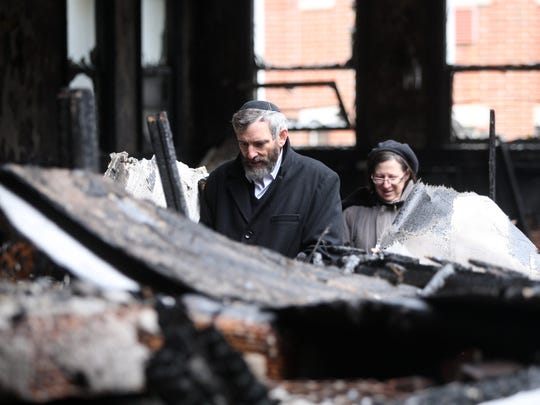 Saul and Georgie London of Highland Park walk through the burned-out wreckage of Congregation Poile Zedek, Sunday, November 22, 2015, in New Brunswick.