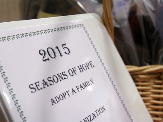A notebook used to log gifts for needy families, Tuesday,