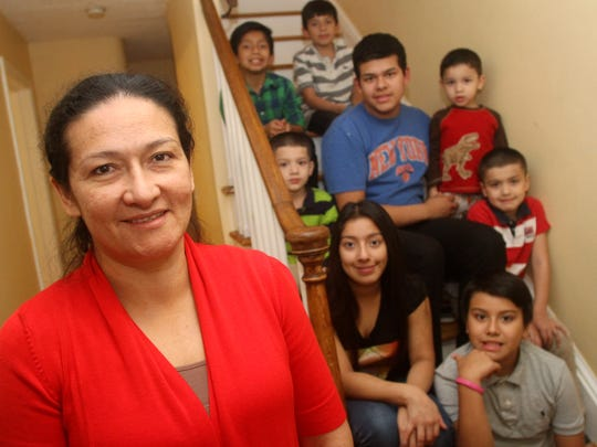 Maria Carrero with her daughter Diana, age 15, and seven sons, Christian, 9, Eduardo, 6, Francisco, 17, Fernando, 5, Rafael, 3, Kevin, 11, and Ricardo, 7, Wednesday, December 2, 2015, in the family's Plainfield home.