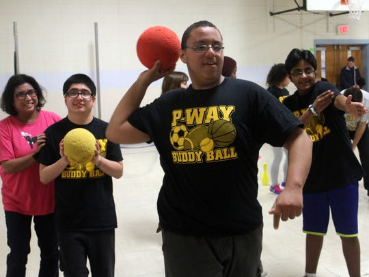 Fifteen-year-old Joey Clyburn throws a ball during a Buddy Ball game, Wednesday, December 2, 2015, in the gymnasium at the Piscataway Board of Education.