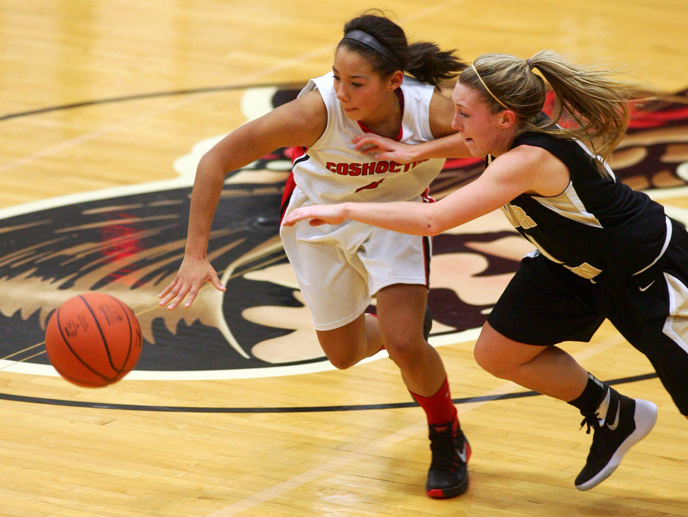 River View Senior Cassidy Whiteus and Coshocton Sophomore Tyra Woods chase after a loose ball Wednesday night during the Black Bears' 41-28 victory.