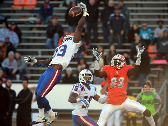 Louisiana Tech's Kentrell Brice reaches to knock a pass away from UTEP receiver Tyler Batson after Batson got behind the defense Saturday. The pass fell incomplete. Louisiana Tech's Bryson Abraham is in the background.