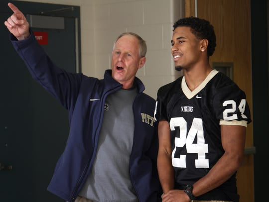 Pittsburgh assistant football coach Tim Salem talks to Rutgers commit Phil Campbell of South Brunswick during a Home News Tribune All-Area photo shoot three years ago.