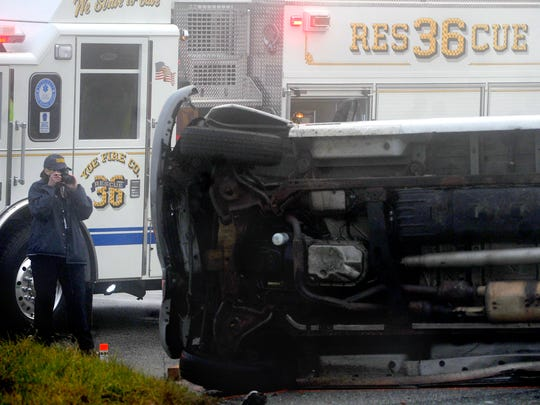 A member of the Coroner's officer was on scene to photograph the aftermath of a fatal accident on Thursday, Dec. 10, 2015. Terry Allen Smith of Windsor died at the intersection of East Prospect and Freysville roads when the van he was a passenger in struck a truck and it rolled over. The driver of both vehicles were being treated at area hospitals.