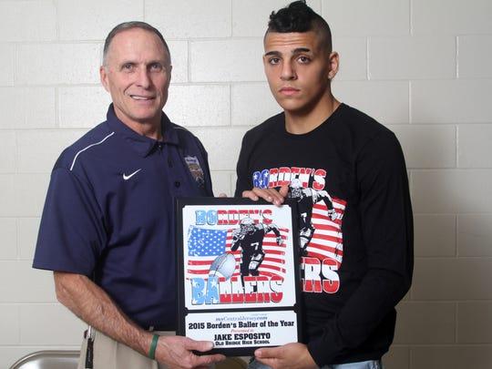 Marcus Borden (left) presents Jake Esposito with 2015 Baller of the Year award