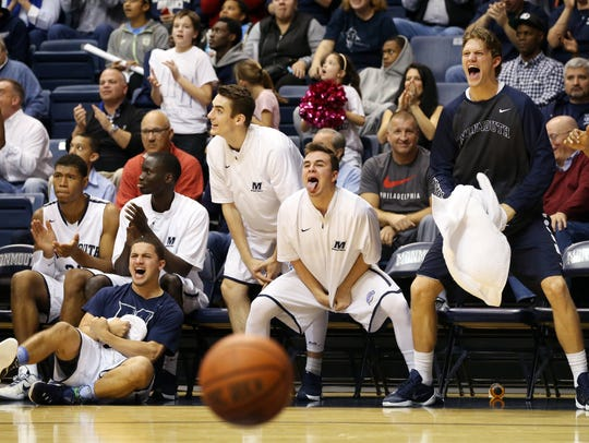 The Monmouth bench reacts to a second half play during