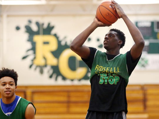 Roselle Catholic's Nazreon Reid works out with his team during a pre-season basketball practice, Monday, December 14, 2015, in Roselle.