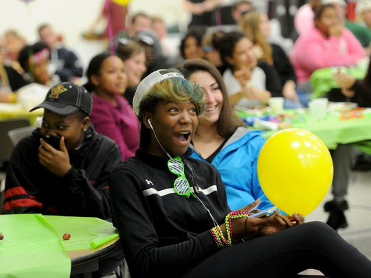 Sabrina Simmons, a freshman at Penn State York, reacts to comedian Adam Grabowski during the Penn State York Late Night Breakfast event Monday. The comedian was part of fun, stress relieving event sponsored by the college to help students through finals.