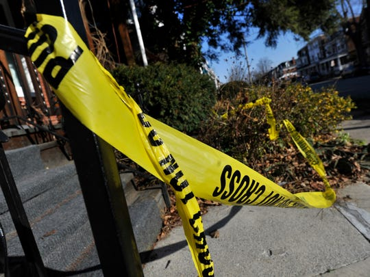 Police tape still remained at the scene of a shooting along the 700 block of Pennsylvania Ave on Saturday morning.