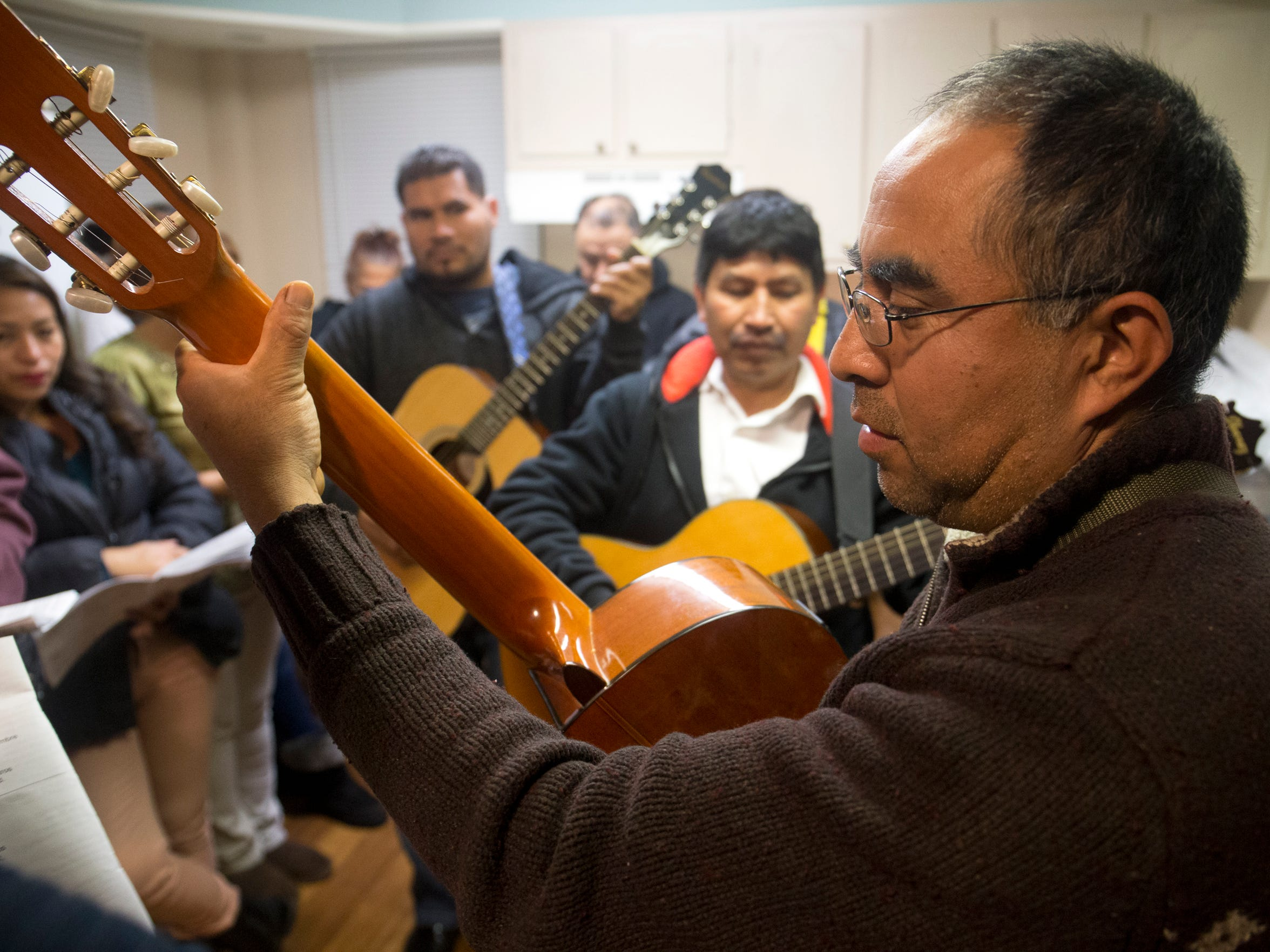 Luis Tapia of Lakewood is among the guitarists playing at an All Saints Episcopal Church celebration of Las Posadas, Monday, December 21, 2015, in Lakewood.