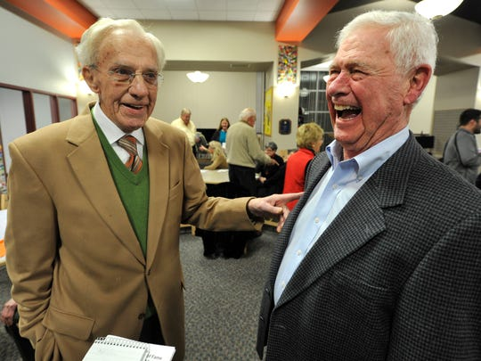 Wilbur Gobrecht, right, reacts to the comments of former teammate Dick Reese during a reception for the duo, who were part of the inaugural inductees into the Hanover Athletic Hall of Fame at Hanover High School on Monday, Dec. 21, 2015. The two were inducted as part of the 1947 football team and Gobrecht was inducted for his individual achievements.