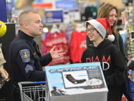 Sgt. Braxton Ditty with the Newberry Township Police department, jokes around with Maxwell Hatterer, after the officer took the boy to Wal-Mart to purchase a new gaming chair.