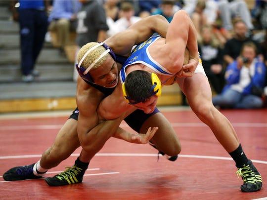 Old Bridge's Xavier Jenkins wrestles Tim Suter of Buena