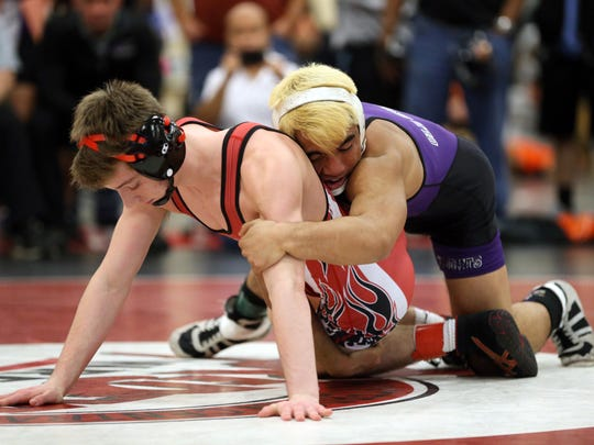 Old Bridge's Stephen Nadera takes on Peter Nace of Hunterdon Central in the 120lb semifinal match at the Hunterdon Central Invitational wrestling tournament, Monday, December 28, 2015, in Flemington.