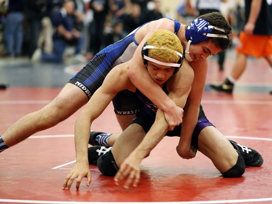 Jeff Johnson of Middlesex wrestles Nezzar Dimes of Old Bridge in the 138lb semifinal match at the Hunterdon Central Invitational wrestling tournament, Monday, December 28, 2015, in Flemington.