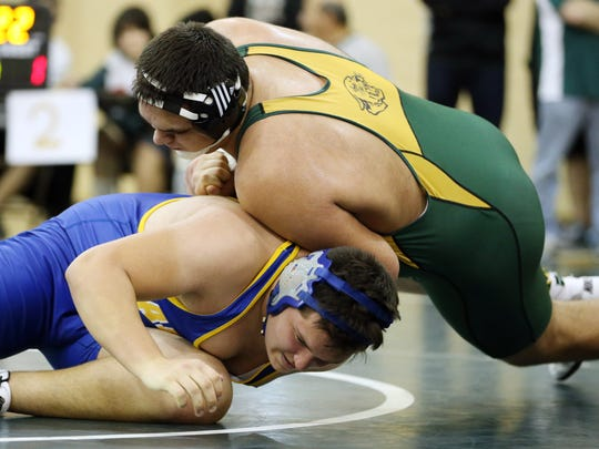 Dylan D'Amore of Montgomery wrestles Michael Tyle of Manville in the 285lb final, Tuesday, December 29, 2015, at the Bear Invitational wrestling tournament in East Brunswick.