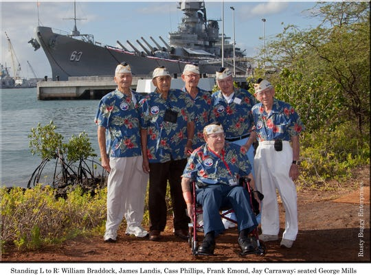Pearl Harbor survivors who were featured on the local military TV show 'FORWARD MARCH!' stand for a photo. From left to right: William Braddock, James Landis, Cass Phillips, Frank Emond, Jay Carroway, George Mills (seated).