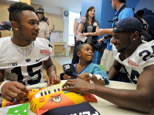 Grant Haley, left, and Nick Scott, played with kids the Wolfson Children's Hospital in Jacksonville, Florida before the TaxSlayer Bowl two seasons ago. While Haley can be outgoing as anyone, his family says a quite, inner-fire stokes his perseverance and success.