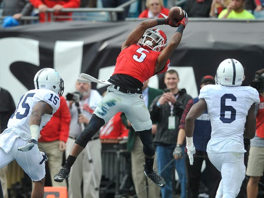 Georgia wide receiver Terry Godwin catches a touchdown pass in the second quarter of Saturday's 24-17 win against Penn State in the TaxSlayer Bowl in Jacksonville, Fla.