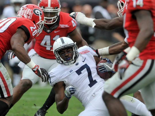 Penn State wide receiver Geno Lewis comes down with