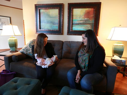 Childbirth educator and doula Lety Knight visited with Jamie Ziegenfuss and daughter Athena at The Retreat. Knight assisted Ziegenfuss and her husband Mark Ziegenfuss deliver Athena.