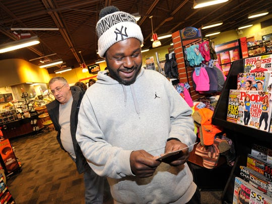 Gerald Gilot of Manchester Township is all smiles as he looks at the Powerball ticket he purchased. The jackpot grew to $800 million Friday, and could go higher.