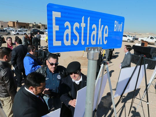 Sal Alonzo of El Paso County, lower left, talks with