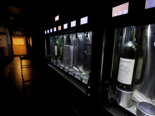 The new wine dispensers installed across from the TT Bar at Tutoni's, photographed here on Thursday, Jan. 14, 2016.
