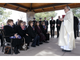 Monsignor Victor Kayrouz offers comfort to the five