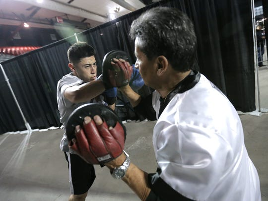 Joshua Gallardo of Espinoza/Rivas Boxing warms up for his 165-pound Golden Gloves bout against Eduardo Monreal of Wolves Den Boxing Saturday at the El Paso County Coliseum.