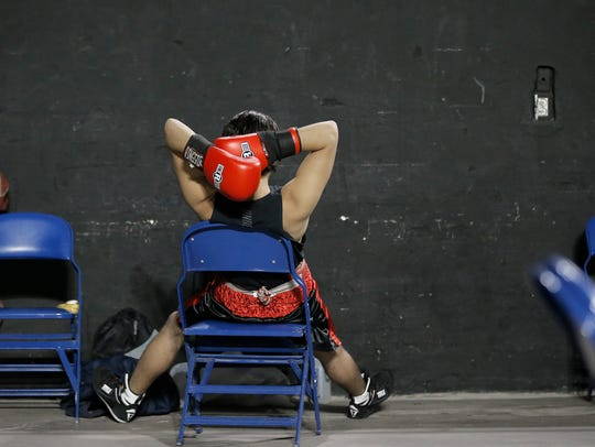 Jason Lugo of Parada Boxing relaxes before his bout