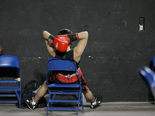 Jason Lugo of Parada Boxing relaxes before his bout against Jose Angel Apodaca of Wolves Den Boxing Saturday during Golden Gloves.
