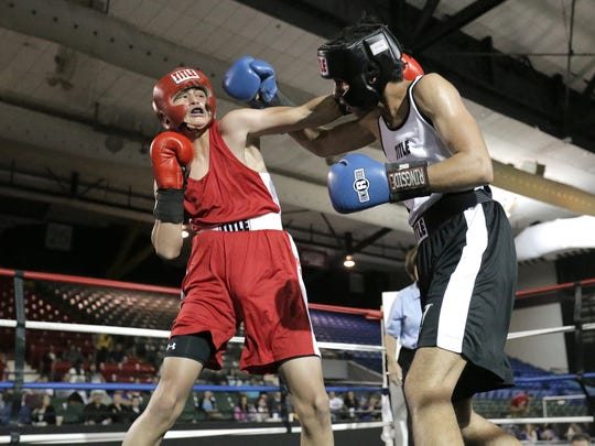Adrian Amparan, right, of TNT Boxing defeated Jose Apodaca of Wolves Den Boxing in their 132-pound Golden Gloves bout Saturday at the El Paso County Coliseum.