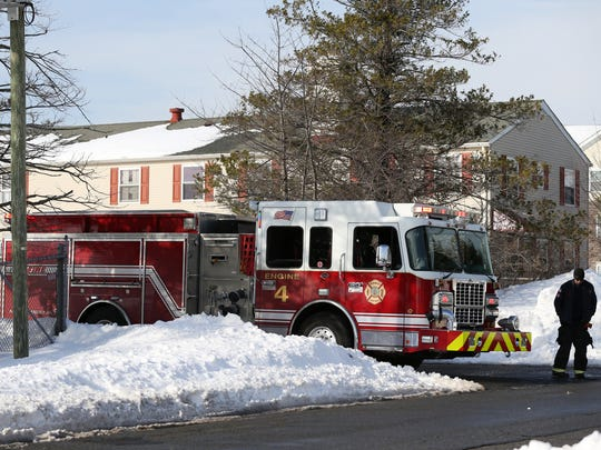 An Edison firetruck is stationed at the scene of a carbon monoxide emergency at the Ozanam Shelter, Monday, Jan. 25, 2016, in Edison.