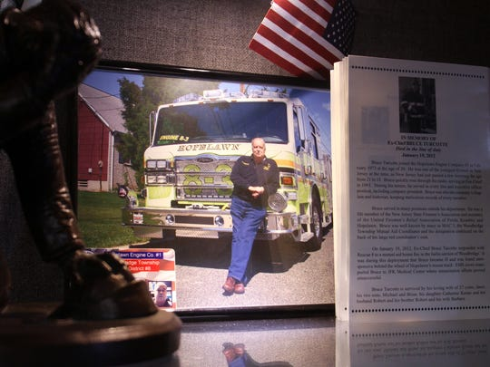 A memorial to Hopelawn volunteer firefighter Bruce Turcotte, who died in the line of duty in 2012, is displayed in Hopelawn Engine Company No.1.