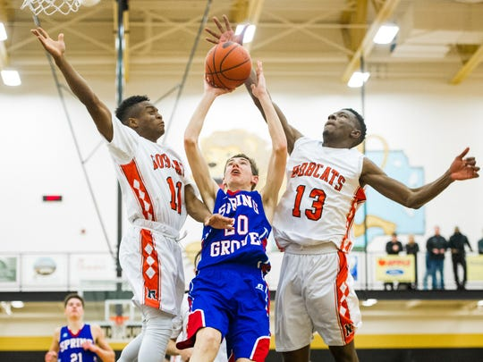 Northeastern's Fred Mulbah (11) and Kobi Nwandu (13) team up for a block but foul Spring Grove's Drew Gordon (20) on a layup attempt in a YAIAA boys' basketball semifinal game at Red Lion Area High School on Thursday, Feb. 11, 2016. Spring Grove won 59-57.