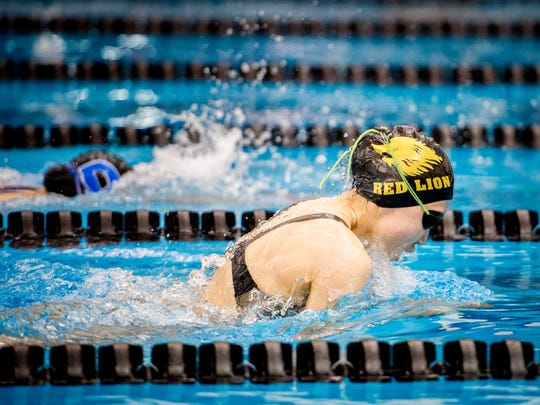 Red Lion's Jessica Sun passes Dallastown's Jena Woods to take first place in the 100-yard breaststroke during the YAIAA league swimming championship on Friday, Feb. 12, 2016.